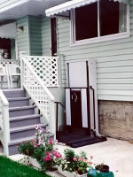 The homeowner built their own gate for this porch lift.